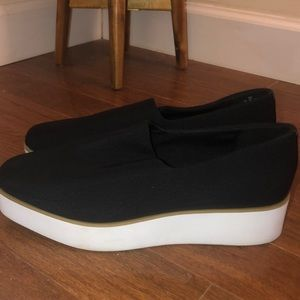 Black DKNY platform shoes with white sole